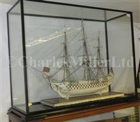 Lot 261-A LARGE, FINELY CARVED AND WELL PRESENTED EARLY 19TH CENTURY NAPOLEONIC FRENCH PRISONER OF WAR BONE SHIP MODEL FOR A FIRST RATE SHIP OF THE LINE TRADITIONALLY IDENTIFIED AS H.M.S. CALEDONIA