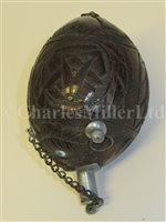 Lot 70-A SAILORWORK CARVED COCONUT BUGBEAR POWER FLASK, FIRST HALF 19TH CENTURY