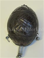 Lot 70 - A SAILORWORK CARVED COCONUT BUGBEAR POWER FLASK, FIRST HALF 19TH CENTURY