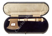 Lot 154 - Ø A SILVER MOUNTED IVORY AND ENAMEL LAUNCHING HATCHET FOR THE S.S. PENTWYN, 1910