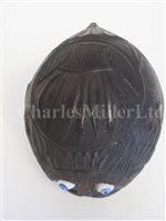 Lot 69-AN EARLY 19TH CENTURY SAILORWORK CARVED COCONUT