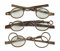 Lot 188 - A PAIR OF EARLY 19TH CENTURY DOUBLE FOLDING TINTED SILVER SPECTACLES; and two others