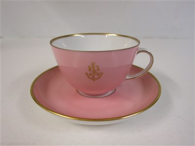 Lot 55-HAMBURG-AMERICAN (H.A.P.A.G.) LINE: A PINK PORCELAIN COFFEE CUP AND SAUCER BY FÜRSTENBERG, GERMANY, CIRCA 1950