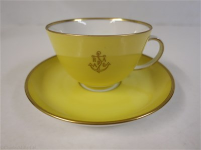 Lot 56-HAMBURG-AMERICAN (H.A.P.A.G.) LINE: A YELLOW PORCELAIN COFFEE CUP AND SAUCER BY FÜRSTENBERG, GERMANY, CIRCA 1950