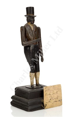 Lot 37-AN UNUSUAL ARTICULATED FIGURINE CARVED FROM TIMBER RECOVERED FROM H.M.S. ROYAL GEORGE, CIRCA 1842