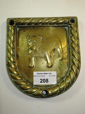 Lot 208 - A BRASS BADGE FROM H.M.S. BULLDOG, CIRCA 1930