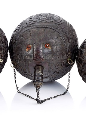 Lot 32-A 19TH CENTURY CARVED COCONUT BUGBEAR
